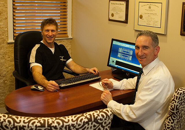 Marlton family dentist, Dr. Sandberg at his desk
