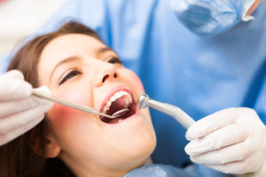 A woman receiving dental treatment